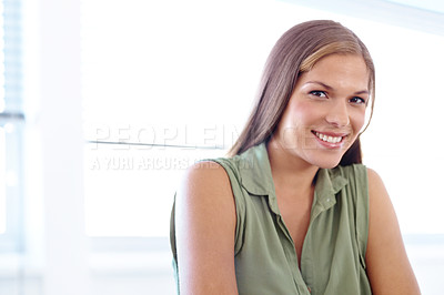 Buy stock photo Portrait of a young female university student sitting at table and smiling at the camera
