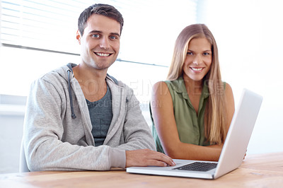 Buy stock photo Portrait of two young university students working on a laptop together