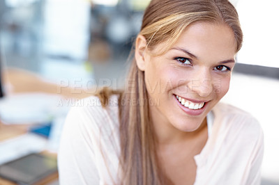 Buy stock photo Closeup of a lovely young businesswoman in an office smiling at the camera - portrait