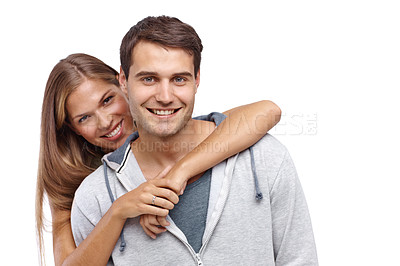 Buy stock photo Happy young girlfriend embracing her boyfriend from behind