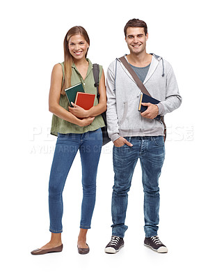 Buy stock photo Young students smiling while holding their textbooks - portrait