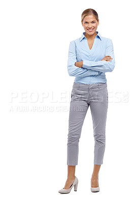 Buy stock photo Beautiful young blonde woman smiling at the camera with her arms folded - full length