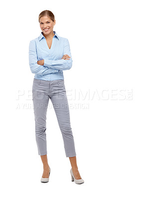 Buy stock photo Young blonde woman smiling at the camera with her arms folded - full length