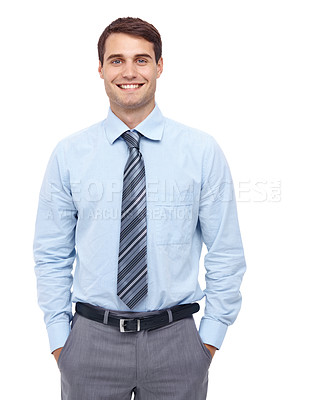 Buy stock photo Happy young businessman standing with his hands in his pockets