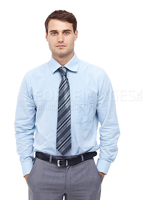 Buy stock photo Handsome young businessman standing with his hands in his pockets