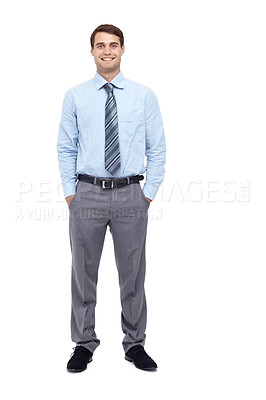 Buy stock photo Happy young businessman standing with his hands in  his pockets - portrait