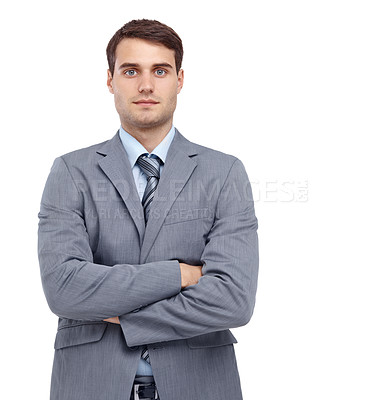 Buy stock photo Handsome young businessman standing with his arms folded