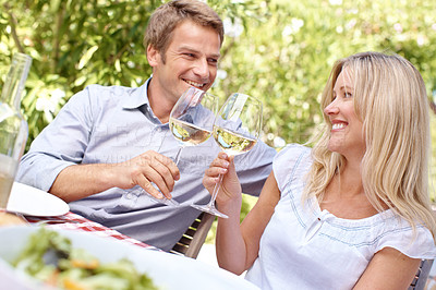 Buy stock photo A mature couple toasting their wine while on a lunch date