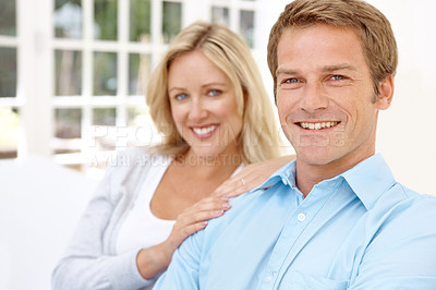Buy stock photo A handsome mature man sitting with his wife in their lounge together