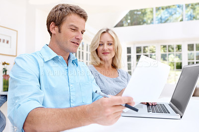 Buy stock photo A mature couple using a laptop to pay their monthly bills