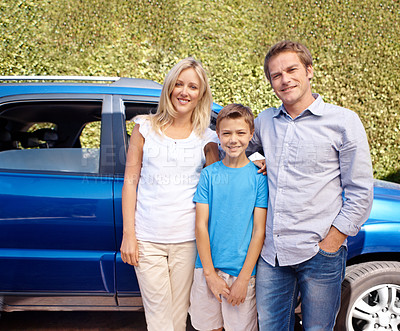 Buy stock photo A mother, father and their son standing outside their car smiling at the camera