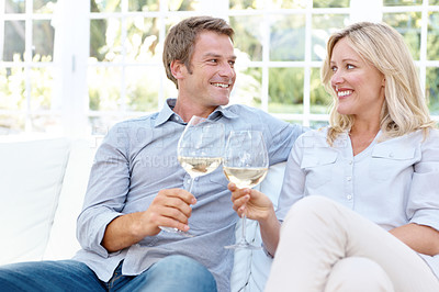 Buy stock photo A happy couple toasting each other with wine in celebration of their love