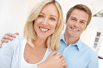 Buy stock photo Portrait of a young couple smiling at the camera
