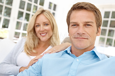 Buy stock photo Closeup portrait of a happy couple sitting on a sofa in their lounge