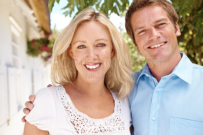 Buy stock photo Attractive mature couple standing outside their house together
