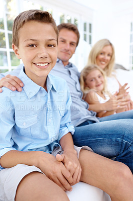 Buy stock photo Happy family relaxing together on the sofa at home