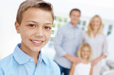 Buy stock photo Smiling little boy with his family in the background
