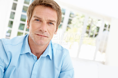 Buy stock photo Cropped view of a handsome mature man looking composed and serious