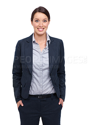 Buy stock photo Smiling young businesswoman against a white background with her hands in her pockets