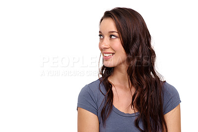 Buy stock photo Attractive young woman looking away against a white background