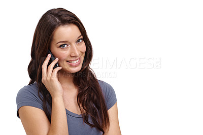 Buy stock photo Attractive young woman using her mobile