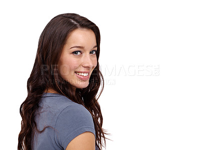 Buy stock photo Pretty young woman smiling while looking over shoulder
