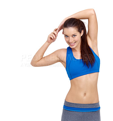 Buy stock photo A fit young woman warming up while isolated on a white background