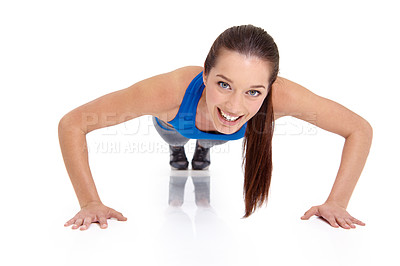 Buy stock photo Portrait of a pretty young woman doing press-ups against a white background