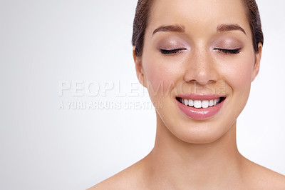 Buy stock photo A young woman with perfect skin smiling with her eyes closed