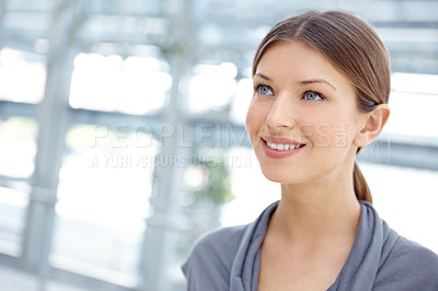 Buy stock photo A pretty young businesswoman looking away thoughtfully alongside copyspace