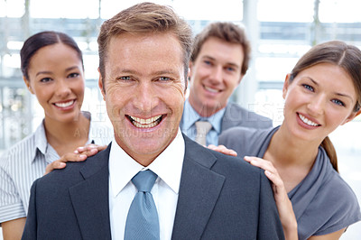 Buy stock photo A business manager being celebrated by his team after sealing another deal