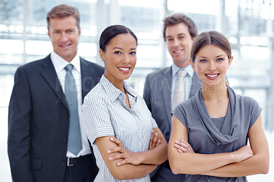 Buy stock photo A successful business team standing together and smiling