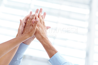 Buy stock photo A business team motivating one another to success - Copyspace