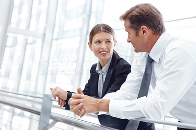 Buy stock photo Two businesspeople having a discussion at the office