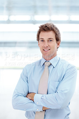 Buy stock photo A handsome young businessman smiling at the camera