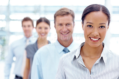 Buy stock photo A group of businesspeople smiling while standing in a row