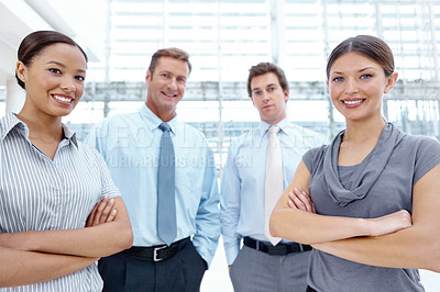 Buy stock photo A team of young businesspeople looking at the camera