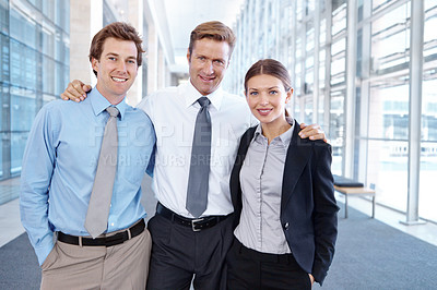 Buy stock photo A handsome boss standing proudly next to his employees