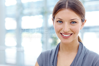 Buy stock photo Beautiful young businesswoman standing and smiling