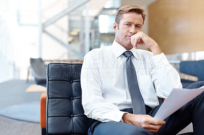 Buy stock photo Mature businessman sitting and thinking contemplatively while holding paperwork