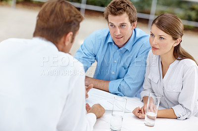 Buy stock photo Young business couple in a meeting with a consultant