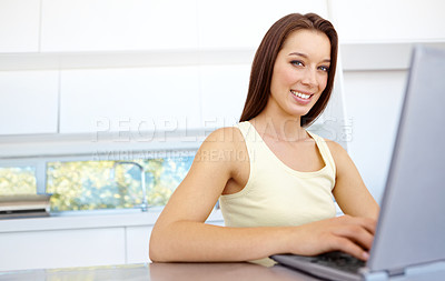 Buy stock photo A pretty woman working on her laptop at home
