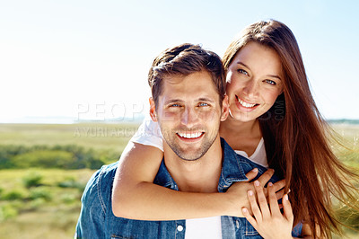 Buy stock photo A portrait of a happy smiling couple enjoying the outdoors