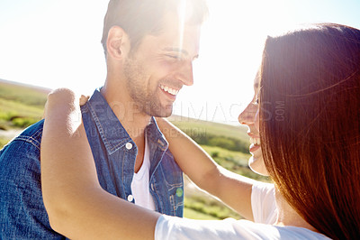 Buy stock photo A couple sharing a happy moment together in the sunshine