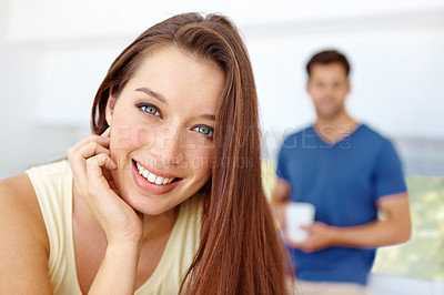 Buy stock photo Young couple standing in there kitchen at home