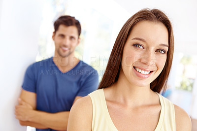 Buy stock photo Cute young couple spending time together at home