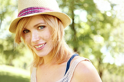 Buy stock photo Portrait of a beautiful young woman wearing a sunhat and looking at the camera