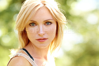 Buy stock photo Portrait of a beautiful young woman in an outdoor environment