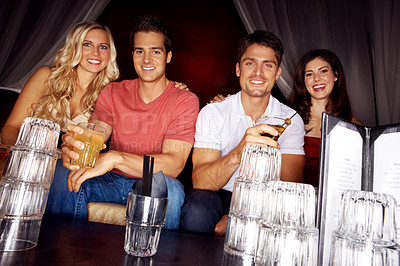 Buy stock photo Two couples drinking in a night club