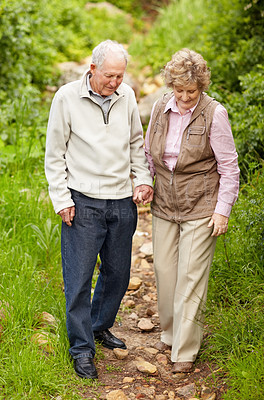 Buy stock photo Full length of a happy mature couple walking together in countryside